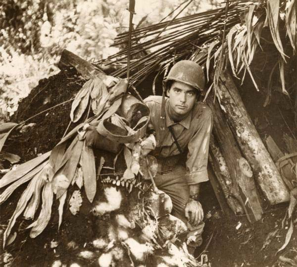 Robert Robert Doyle emerges from a captured Japanese pillbox at Buna, New Guinea, (present day Papua New Guinea).