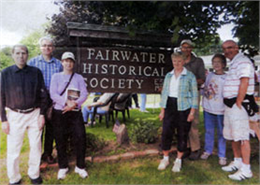 A group tour stands near the Fairwater Historical Society sign.