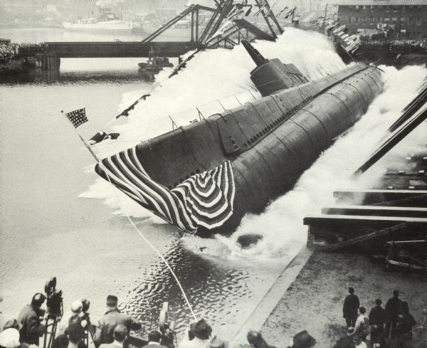 A submarine lying on its side in the lake after being launched.