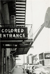 Exterior view of the segregated entrance for African-Americans at Malco Theater.