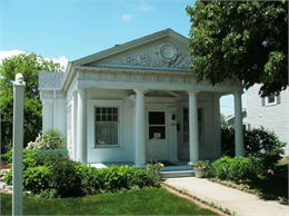 Exterior of building with white pillars, the De Pere Historical Society headquarters.