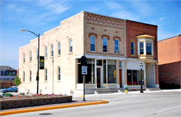 Exterior of commercial main street brick buildings.