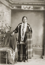 Standing portrait of a Ho-Chunk woman in native dress.