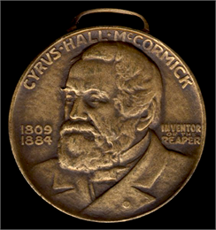 Front side of a coin featuring head and shoulders portrait of Cyrus Hall McCormick