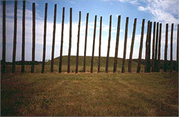 A platform mound at Aztalan, seen through the reconstructed palisade.