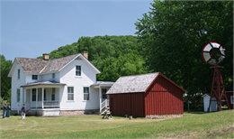 The exterior of two farm buildings located at the Stonefield Historic Site.