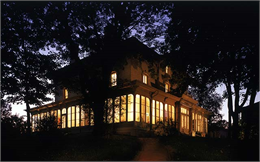 The historic Villa Louis mansion illuminated at twilight
