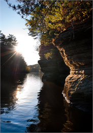 Photograph of sunrise over cliffs of the Dells of the Wisconsin river