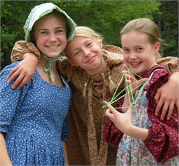 Three girls sporting Laura Ingalls Wilder attire take part in Old World Wisconsin's World of Little House event.