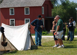 Visitors chat with a Civil War re-enactor at Old World Wisconsin