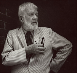 Paul Vanderbilt posed against a dark background.