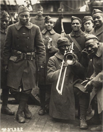 African-American soldiers during World War I enjoy trombone music.