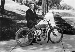 Walter Davidson posing with his motorcycle after winning the Endurance Race in 1908.