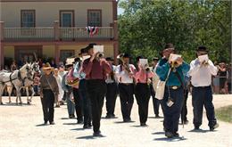 The July 4 parade runs through the crossroads village.