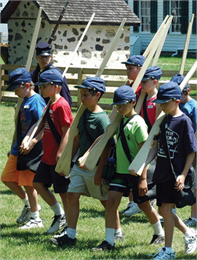 Civil War day camp participants marching