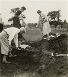 W.P. and Vivian Morgan and Grace Rollins excavate a burial mound.