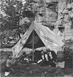 (Right to left) William Metcalfe, H. H. Bennett, and two unidentified men on a camping trip to Juneau County