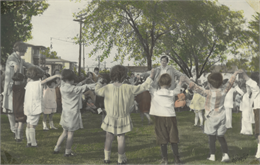 Hand-colored photo of a circle game at Neighborhood House, 1929.