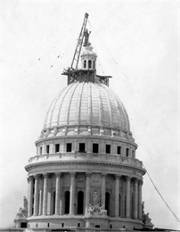 putting statue on capitol