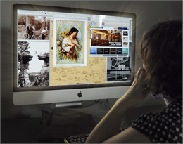 A researcher looks at a computer screen filled with six historic images from the Society's collections.