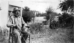 Thomas Green sitting in a rocking chair.