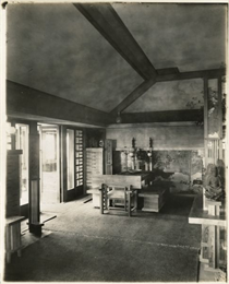 Dining room in Taliesin II. Several pieces of Asian art decorate the space.