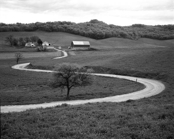 A winding road leading to a farm.