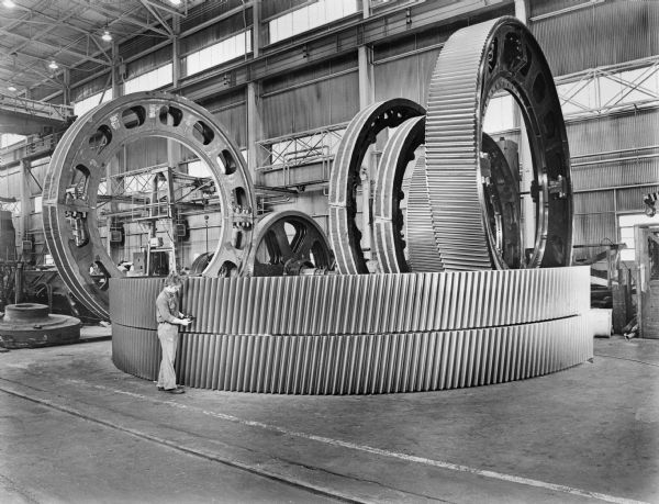 Large ring gears in various stages of manufacture waiting for subsequent machining operations.
