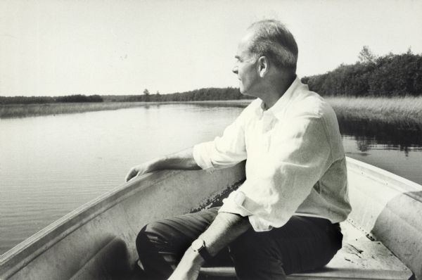 Gaylord Nelson turned sideways in a canoe, looking out across the lake.