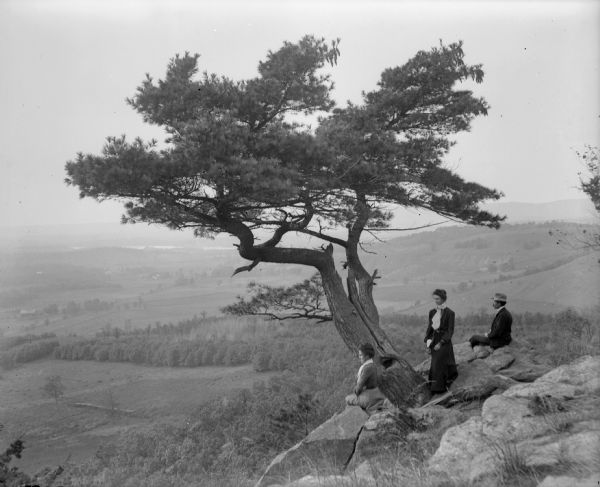 Two women and a man pose atop Gibraltar Rock in Richmond Memorial Park.