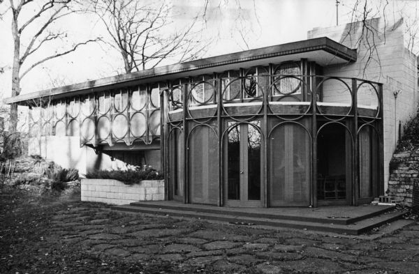 The circular motifs above the veranda are purely decorative, but those under the roof serve as a truss support.