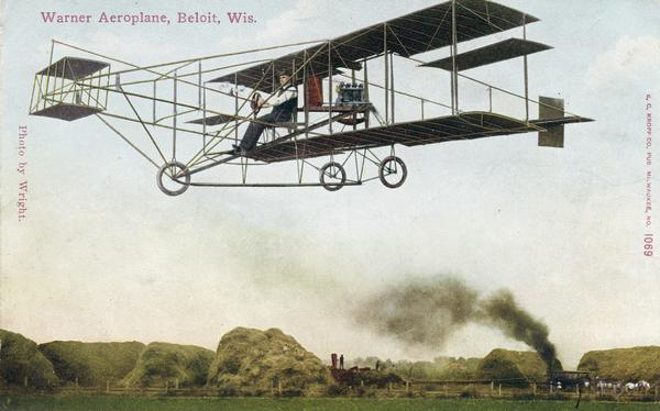 Color postcard depicting Arthur Pratt Warner of Beloit flying his Curtiss Pusher for the first time, November 4, 1909.