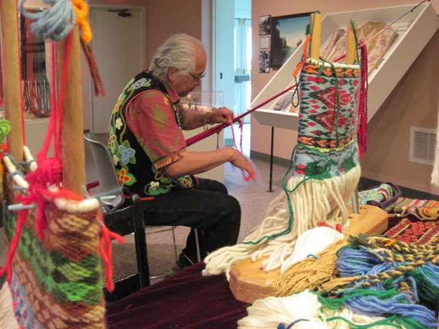 Dennis White practices yarn weaving.