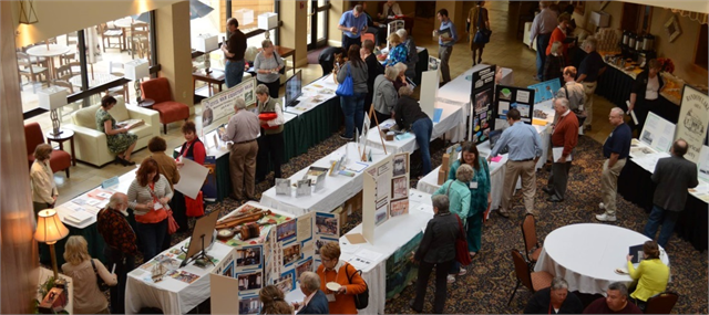 Conference attendees gathered around Town Square tables at a Local History-Historic Preservation Conference.