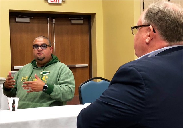 Jason Schlender, Vice Chair of the Lac Courte Oreilles Tribal Governing Board, shares stories of his tribe's history during the new museum engagement session in Hayward.