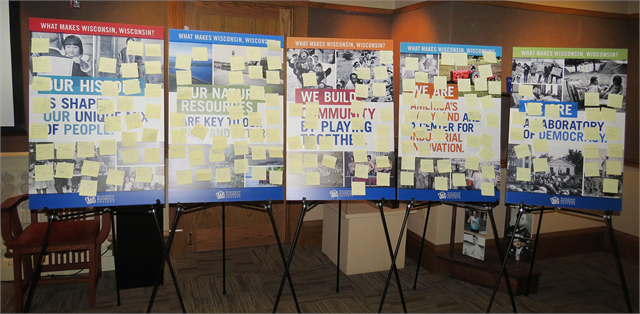 "Post-It notes with suggestions from Janesville guests fill the ""What Makes Wisconsin, Wisconsin?"" theme boards."
