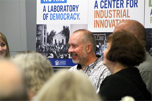 "Robert Quené, Interim Executive Director of the Fairlawn Mansion & Museum in Superior, enjoys a laugh during a discussion about favorite museum experiences at the first ""Share Your Voice"" session in Superior on Oct. 1, 2018."