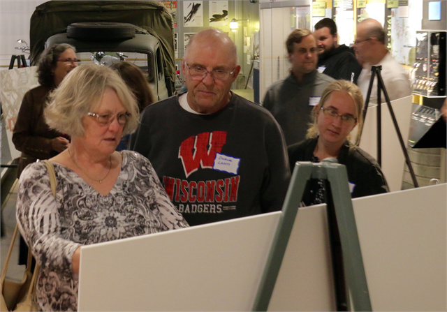 "Guests examine new museum exhibit design concept renderings during the ""Share Your Voice"" session at the Richard I. Bong Veterans Historical Center in Superior."