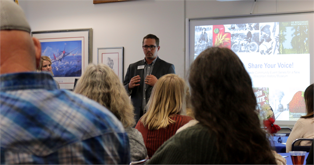"Hayes Scriven, Director of the Richard I. Bong Veterans Historical Center in Superior, welcomes guest and Society staff to the facility at the start of the ""Share Your Voice"" session on Oct. 1, 2018."