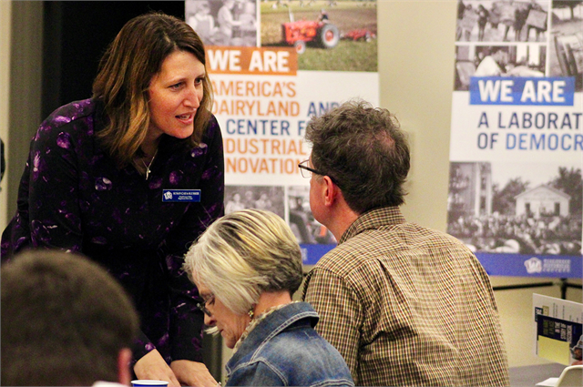 "Susan Caya-Slusser, the Wisconsin Historical Society's Southwest Sites Regional Director, helps a guest at the Society's ""Share Your Voice"" new museum listening session May 2, 2019 at the Platteville Public Library."