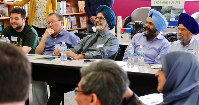 "Guests enjoy a laugh while discussing ideas during the Wisconsin Historical Society's ""Share Your Voice"" new museum multicultural listening session May 15, 2019 at the Islamic Resource Center in the Milwaukee suburb of Greenfield."