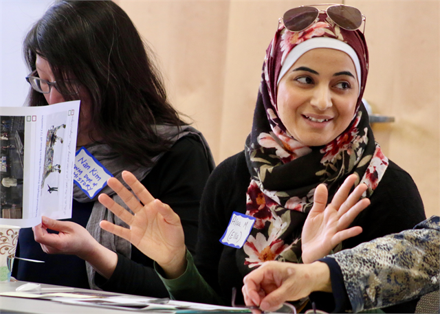 "Alaa Mohammed smiles as she shares a comment during the Wisconsin Historical Society's ""Share Your Voice"" multicultural listening session."