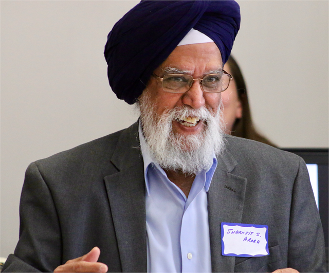 "Swarnjit S. Arora laughs as he shares a story during the Wisconsin Historical Society's ""Share Your Voice"" new museum multicultural listening session May 15, 2019 at the Islamic Resource Center in the Milwaukee suburb of Greenfield."