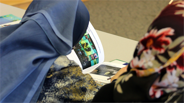"Guests examine new museum exhibit design concept renderings during the Society's ""Share Your Voice"" multicultural listening session May 15, 2019 at the Islamic Resource Center in Greenfield."