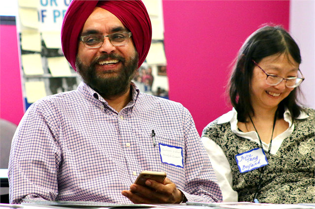 "Gurcheran Grewal, left, and Joyce Tang Boyland enjoy a laugh during a discussion at the Wisconsin Historical Society's ""Share Your Voice"" new museum multicultural listening session May 15, 2019 at the Islamic Resource Center in Greenfield."