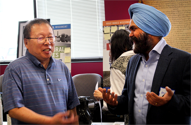 "Ping Lee, left, and Anup Singh share a laugh as they chat following the Wisconsin Historical Society's ""Share Your Voice"" new museum multicultural listening session at the Islamic Resource Center in Greenfield."