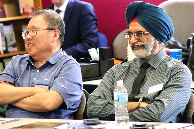 "Ping Lee, left, and Mohan Singh Dhariwal enjoy a laugh during the Wisconsin Historical Society's ""Share Your Voice"" new museum multicultural listening session May 15, 2019 at the Islamic Resource Center in the suburb of Greenfield."