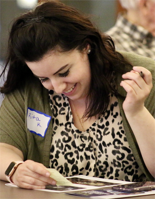 "Rita Kemen chuckles while she writes down suggestions on a Post-It note during the ""Share Your Voice"" new museum listening session May 22, 2019 at the Civil War Museum in Kenosha."
