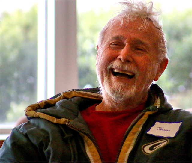 "Thomas Sentieri laughs after commenting on a supper club exhibit concept. ""When you think of Wisconsin, you think of ... being up north in the woods by a nice friendly fireplace and having an Old Fashioned and a nice fish fry. I mean, that's living."""