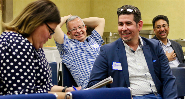 "Guests enjoy a laugh during the Wisconsin Historical Society's ""Share Your Voice"" new museum multicultural listening session for the Latinx community of Milwaukee on May 15, 2019 at the United Community Center."